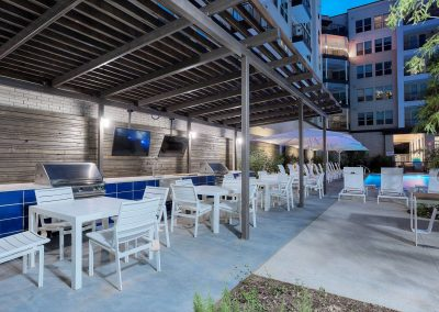 Covered Grill and Outdoor Dining Area with Televisions